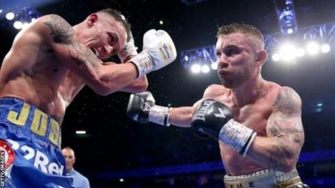 Josh Warrington defends a punch from Carl Frampton