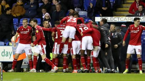 Forest players celebrate Ben Watson's 966th-minute strike