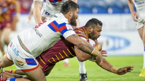 Wakefield's David Fifita is unable to prevent Huddersfield's Ukuma Ta'ai scoring a try
