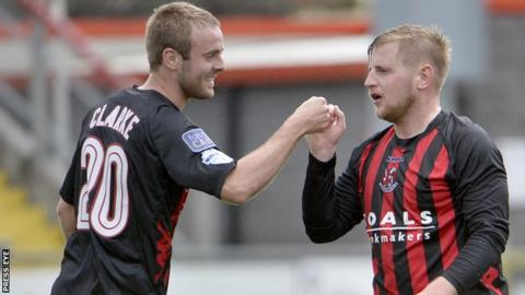 Richard Clarke celebrates a goal by Crusaders new boy David Cushley during a pre-season friendly with Annan Athletic
