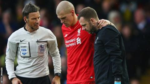 Martin Skrtel is helped off the pitch