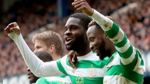 Odsonne Edouard celebrates scoring Celtic's third goal with Moussa Dembele