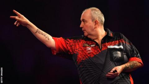 Phil Taylor throws a dart