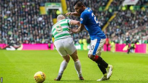 Scott Brown and Alfredo Morelos contest possession in a league match between Celtic and Rangers