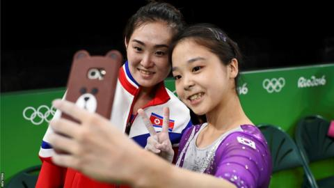 Lee Eun-Ju (KOR) of South Korea takes a selfie with Hong Un Jong (PRK) of North Korea