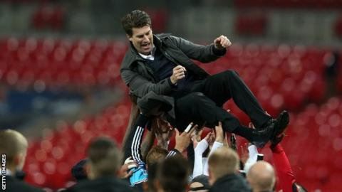 Michael Laudrup is thrown in the air by Swansea City players after the 2013 League Cup final
