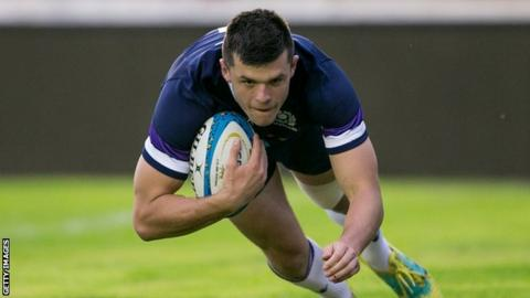 Blair Kinghorn dives over to score a try for Scotland