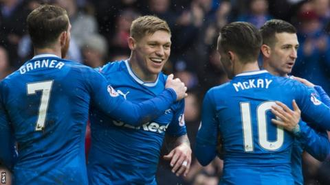 Rangers striker Martyn Waghorn (second left) celebrates