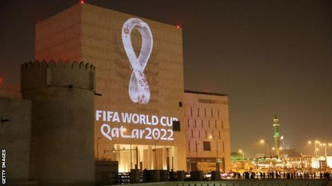 The 2022 World Cup logo projected onto a building in Qatar