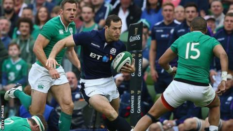 Scotland's Tim Visser bursts between Gordon D'Arcy and Simon Zebo