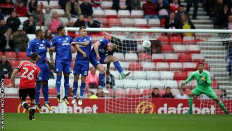The Cardiff City wall holds firm against a free kick from George Honeyman of Sunderland
