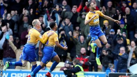 CJ Hamilton celebrates putting Mansfield 2-0 up against Notts County