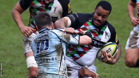 Harlequins' Darryl Marfo is tackled by Ceri Sweeney of Cardiff