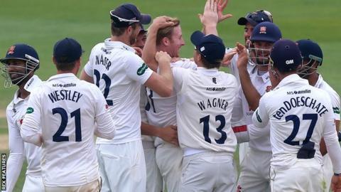 Essex celebrate a wicket against Warwickshire