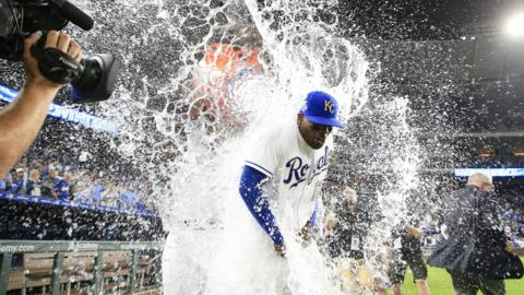 Jorge Soler of the Kansas City Royals gets water dumped on him by teammate Salvador Perez