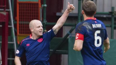 Steven Naismith celebrates a goal for Hearts