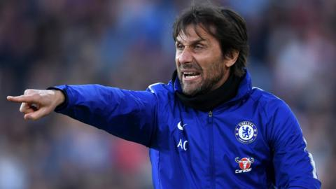 Conte gestures to his players