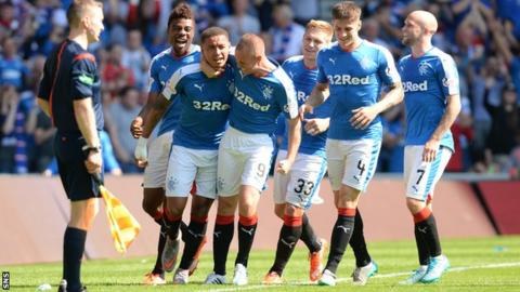 Rangers players celebrate at Ibrox