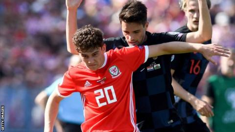 Wales wing Daniel James holds off Croatia defender Josip Brekalo