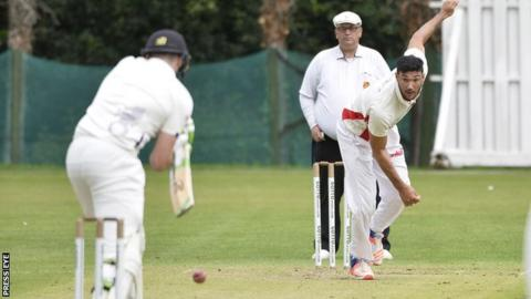 Waringstown bowler Shaheem Khan sends down a delivery in Saturday's league win over Instonians