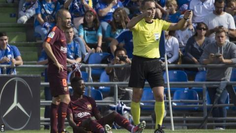 Barcelona forward Ousmane Dembele (centre)