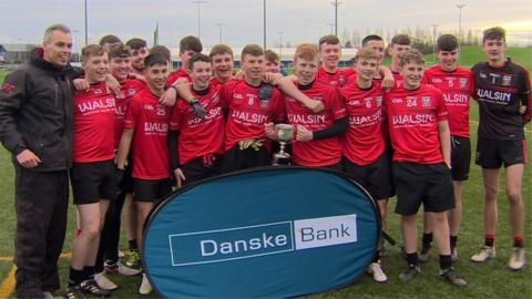 Lagan College's players and manager Gary Connolly after their team's triumph over Drumragh Integrated in the JJ Reilly Cup final
