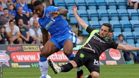 Cheltenham's Ryan Jackson is tackled by Nicky Clark for Bury