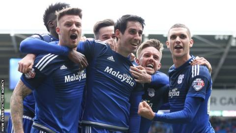 Cardiff players celebrate Peter Whittingham's injury time penalty