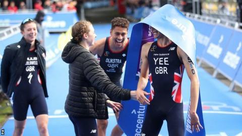 The British team hug on the finish line