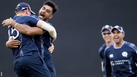 Scotland's Safyaan Sharif celebrates as Scotland win by six runs
