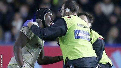 Maro Itoje receives treatment for a jaw injury