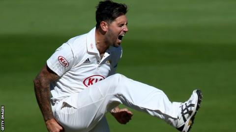 Jade Dernbach celebrates a wicket for Surrey