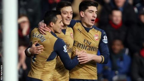Arsenal celebrate scoring in an FA Cup tie