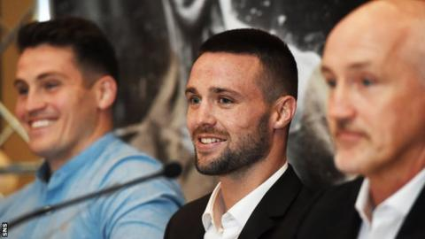 Josh Taylor (centre) is flanked by Shane McGuigan (left) and Barry McGuigan (right)