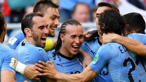 Uruguay celebrate after scoring their second goal against Russia