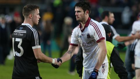 Handhakes all round after Slaughtneil had secured their second Ulster title in three years by beating Kilcoo by a three-point margin in Armagh