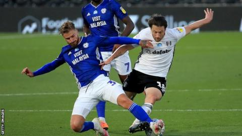 Cardiff and Fulham players challenge for the ball - Joe Bennett and Harry Arter