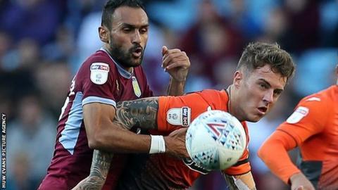 Joe Rodon in action for Swansea against Aston Villa