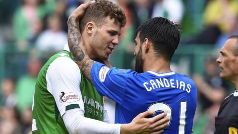 Hibs' Florain Kamberi and Rangers' Daniel Candeias embrace
