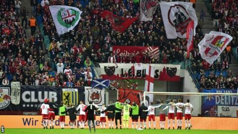 RB Leipzig players celebrate a win with their fans