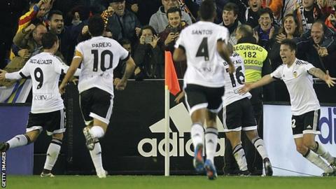 Valencia's players celebrate equalising against Barcelona