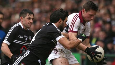Kilcoo's Niall Branagan attempts to win the ball from Se McGuigan of Slaughtneil