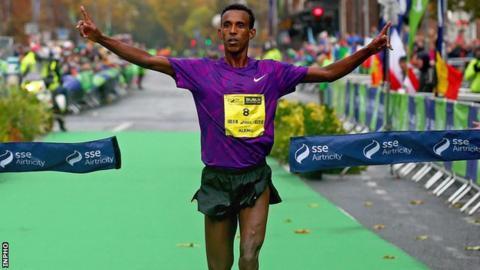 Alemu Gemechu crosses the line to win the Dublin Marathon
