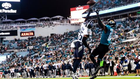 Jacksonville, Florida, 19 September: Tennessee Titans cornerback Logan Ryan attempts to block a high pass into the end zone to wide receiver Dede Westbrook of the Jacksonville Jaguars at TIAA Bank Field. (Photo by Harry Aaron/Getty Images)