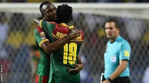 Vincent Aboubakar and Robert Ndip Tambe celebrate after Cameroon sealed a quarter-finals spot