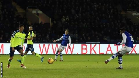 Lucas Joao leans back and sweeps in Sheffield Wednesday's first goal against Derby