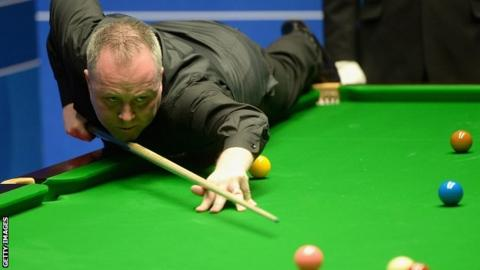 John Higgins plays a pot during his win over Ryan Day
