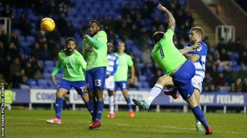 Lee Tomlin's goal in time added on rescued a 2-2 draw for Cardiff when they faced Reading in December