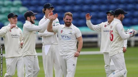 Glamorgan players celebrate a wicket during the pre-season fixture against Cardiff MCCU