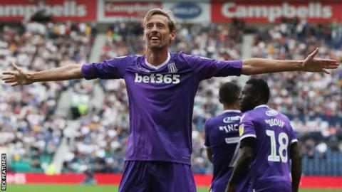 Stoke City striker Peter Crouch celebrates his goal against Preston